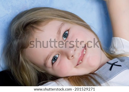 Portrait of cute toothless girl with blond hair - stock photo