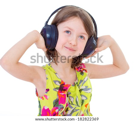 Portrait of cute 7 years girl wearing headphones over a white background