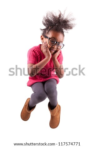 Portrait of cute Young African American girl jumping, over white background