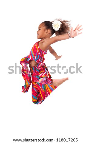 Portrait of cute Young African Asian  girl jumping, over gray background - stock photo