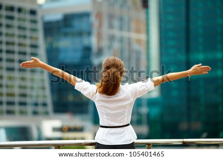 Portrait of cute young business woman outdoor with hands spread - stock photo