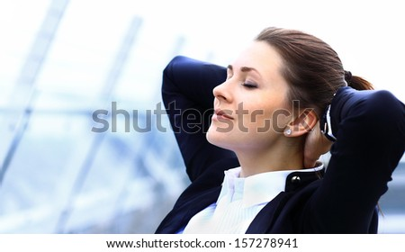 Portrait of cute young business woman relaxing outdoor - stock photo