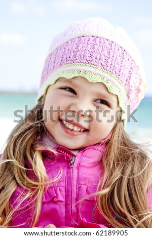 Portrait of cute young girl on the beach - stock photo