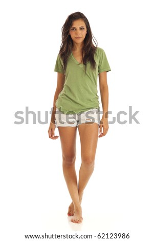Portrait of cute young girl with t-shirt and shorts standing - stock photo