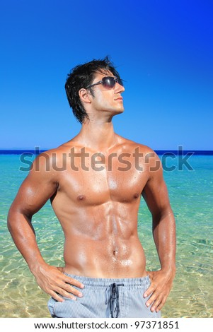 Portrait of cute young man on the beach - stock photo