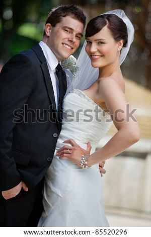 Portrait of cute young married couple posing - stock photo