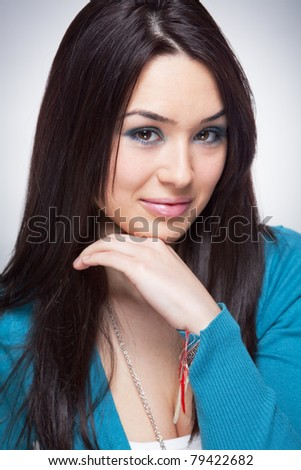 Portrait of cute young woman with nice smile