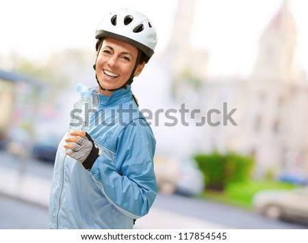 Portrait Of Cyclist Middle Aged Woman, Outdoor - stock photo