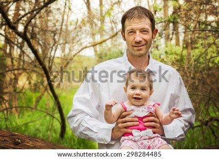 portrait of daddy and daughter in the woods in the summer  - stock photo