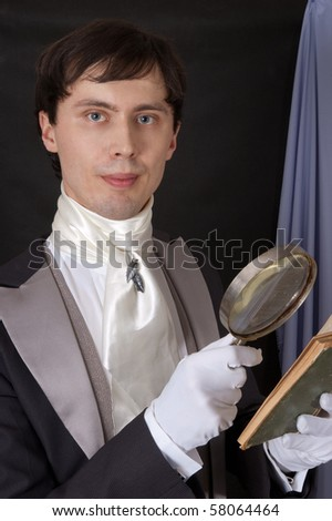 portrait of dandy with magnifying glass