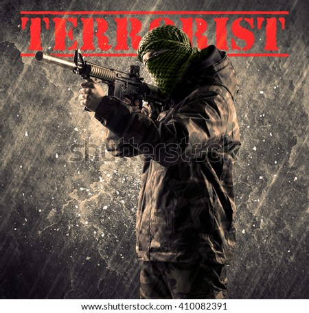 Portrait of dangerous masked and armed man with terrorist sign on grungy background - stock photo