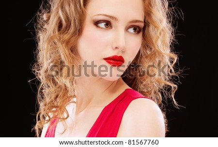 Portrait of darling girl in red dress on black background. - stock photo