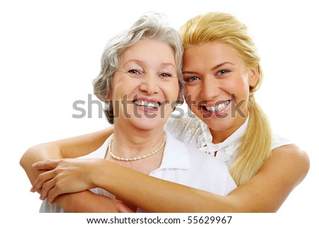 Portrait of daughter embracing her mother and looking at camera - stock photo