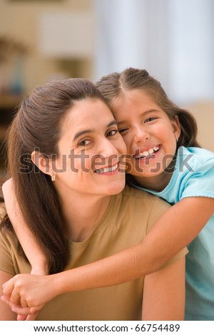 Portrait of daughter hugging mother - stock photo
