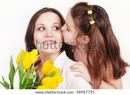 Portrait of Daughter kissing her mother - stock photo