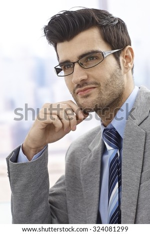 Portrait of daydreaming businessman, looking away. - stock photo