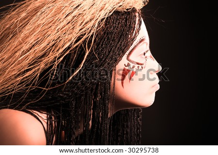 Portrait of decorated ethnic young woman - stock photo