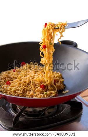 portrait of delicious spicy fried noodle in frying pan - stock photo