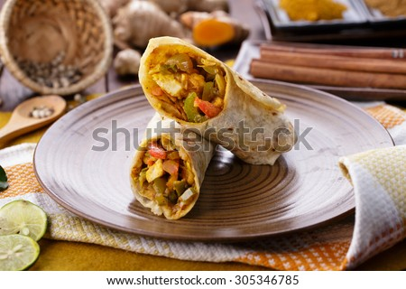 portrait of delicious spicy indian wrap paneer tikka - stock photo