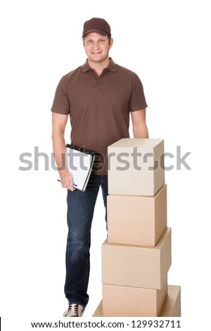 Portrait of delivery man doing paperwork. Isolated on white background - stock photo