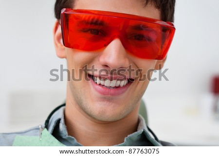 Portrait of dental patient wearing protective eyewear - stock photo