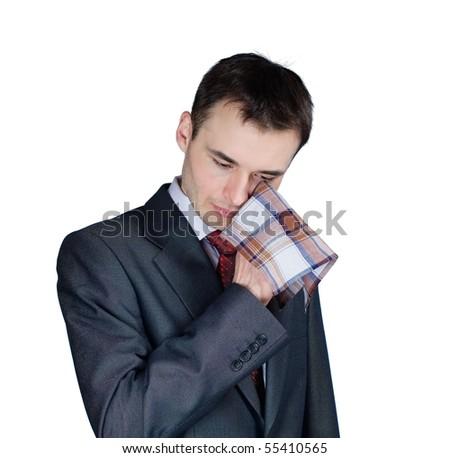 portrait of depressed businessman drying the eyes - stock photo