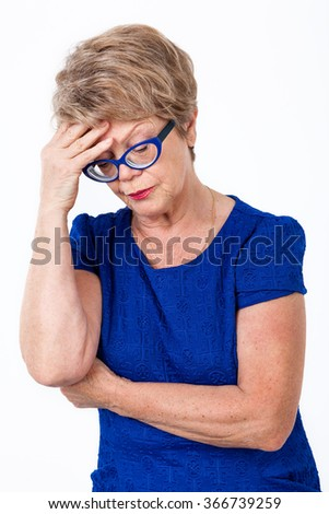Portrait of depressed senior Caucasian woman, white background - stock photo