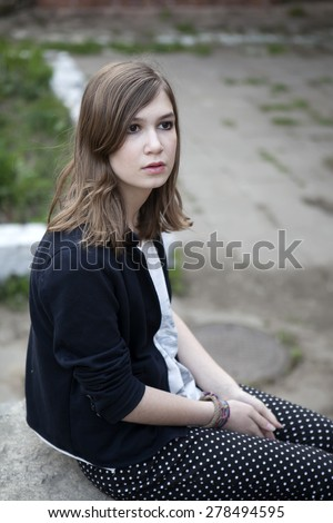 Portrait of depressed teenage girl - stock photo