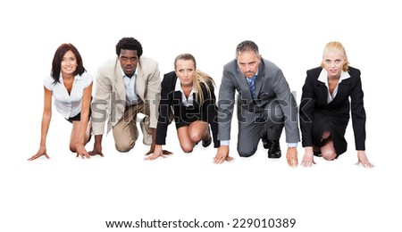 Portrait of determined multiethnic businesspeople ready to race against white background - stock photo