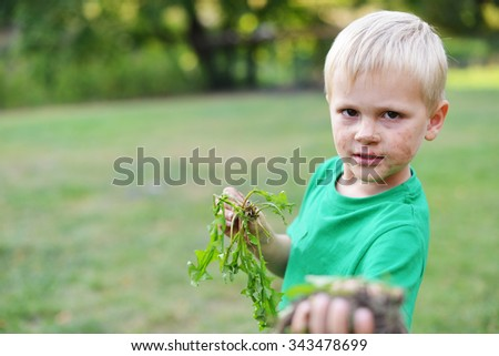 Portrait of dirty little boy - stock photo