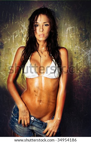 portrait of dirty sexy woman with bikini and wet hair - stock photo