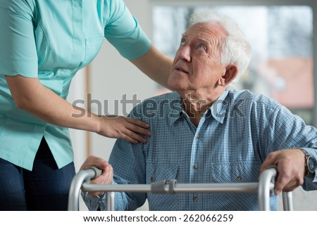 Portrait of disabled senior in care home - stock photo