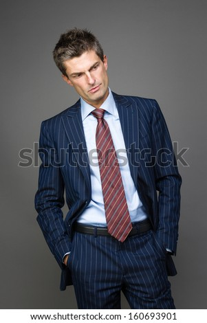 Portrait of disappointed businessman looking aside - stock photo