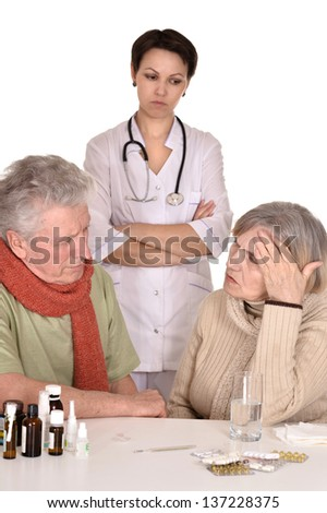 portrait of doctor and sick older caucasian couple over white background