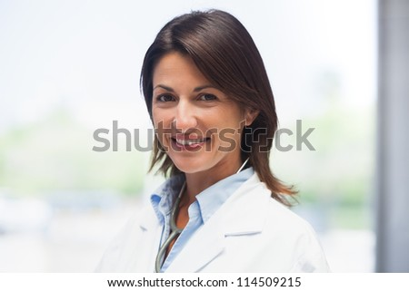 Portrait of doctor in lab coat in hospital - stock photo