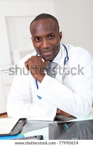 Portrait of doctor in office - stock photo