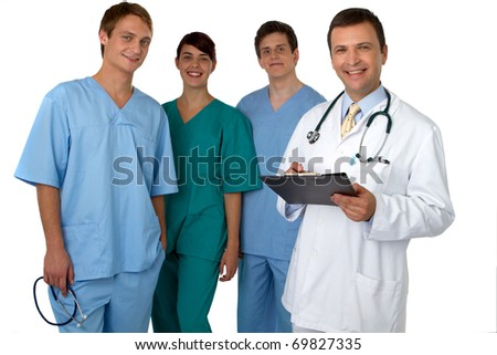 Portrait of doctor with three practitioners in the background - stock photo