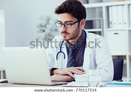 Portrait Doctor Working On Computer Medical Stock Photo (Royalty ...