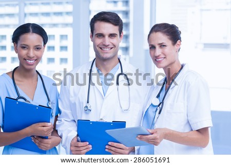 Portrait of doctors with arms crossed at medical office - stock photo