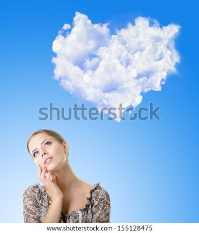 Portrait of dreaming and planing girl looking up into the sky with heart of white clouds - stock photo