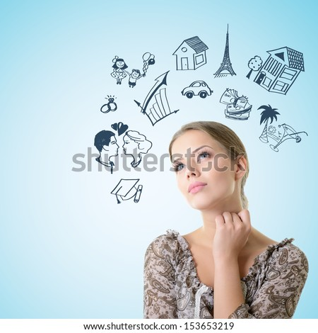 Portrait of dreaming girl looking up into the corner making future plans, over blue background with copyspace - stock photo