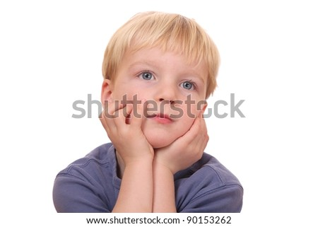 Portrait of dreaming young boy on white background