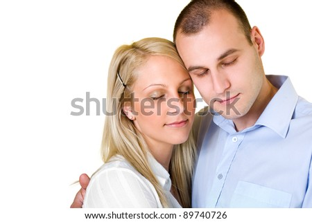 Portrait of dreamy young couple isolated on white background. - stock photo