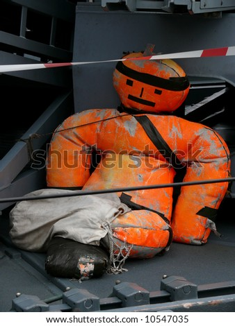 portrait of dummy on military boat - stock photo