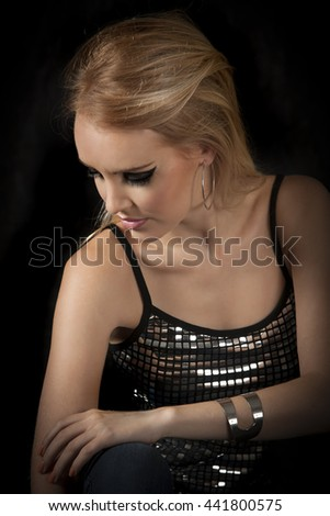 Portrait of edgy blonde woman with dramatic eyeliner - stock photo