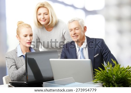 Portrait of efficiency sales team in front of computer and consulting from business plan. Teamwork at office.  - stock photo