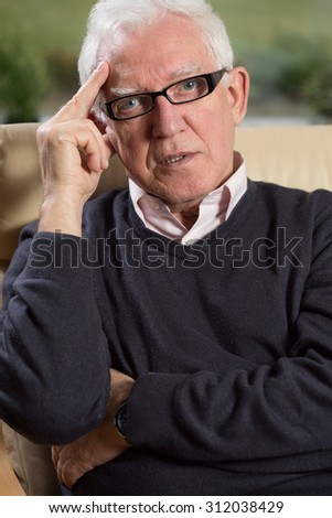 Portrait of elder elegant man working as psychotherapist - stock photo