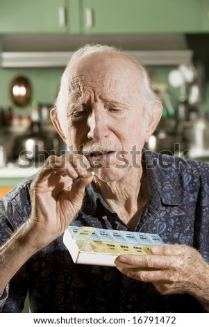 Portrait of Elder Man Discussing Medications - stock photo
