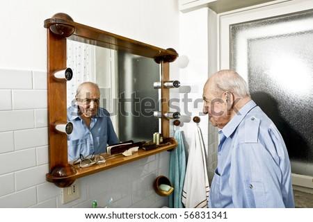 portrait of elder man in the bathroom - stock photo