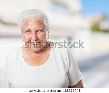 portrait of elder woman smiling enjoying her leisure - stock photo